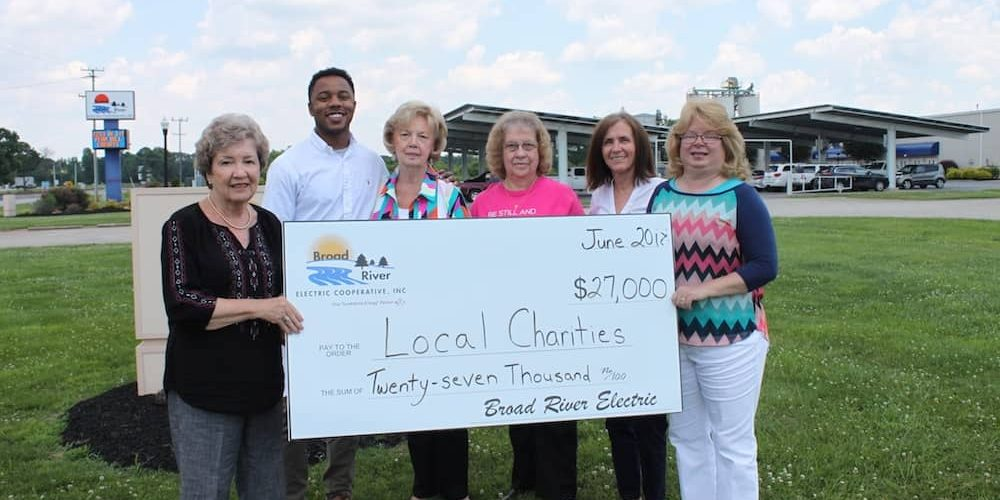 Broad River Electric Charities board member Nancy Jordan (far left) presents the donation check to representatives of organizations doing work in Cherokee County: (l-r) Johnny McLean - Salvation Army, Judy Nix - Cherokee Children's Home, Mildred Robinson - Voice of Triumph, Sherry Stevens - SAFE Homes, and Melissa Green - Iron City Ministries.